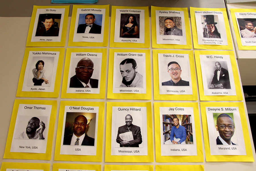 "The wall in the band room that houses the pictures of all composers of color that the bands are playing music from this year. ""One of the many purposes of playing music by composers of color was to help students of non-white background feel inspired to not only stay in a music ensemble here at South, but to also consider having a future in music at the college level,"" said Sayre. ""Another [purpose] is certainly to help our community understand that music of all genres is written and appreciated by all kinds of people."""