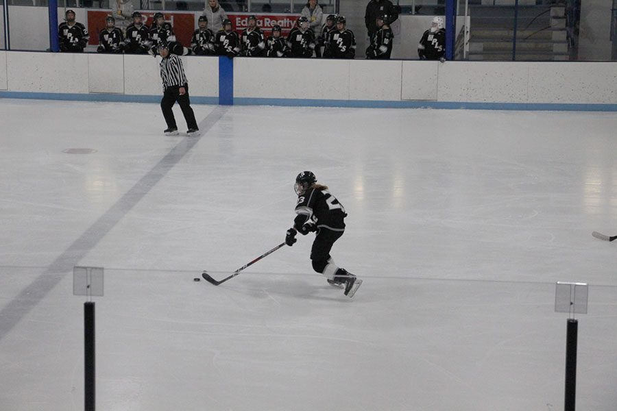Hockey fees at South are getting more expensive. Senior Julia Offerdal races down the ice as part of the hockey team for Minneapolis.
