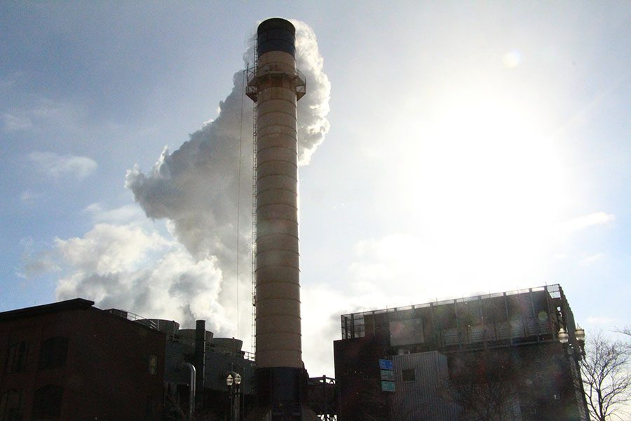 "A smokestack releases smoke from a building. According to the non-profit CDP and the Climate Accountability Institute, 71% of global carbon emissions come from just 100 corporations. ""(blaming average people for global warming) a really good way for people in power to not take responsibility."" Said Guille Bastian."