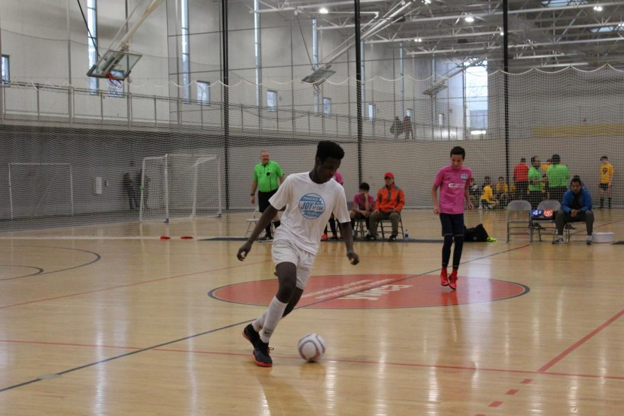 Andrew Njogu playing in the playoff game for his futsal club team JOTP