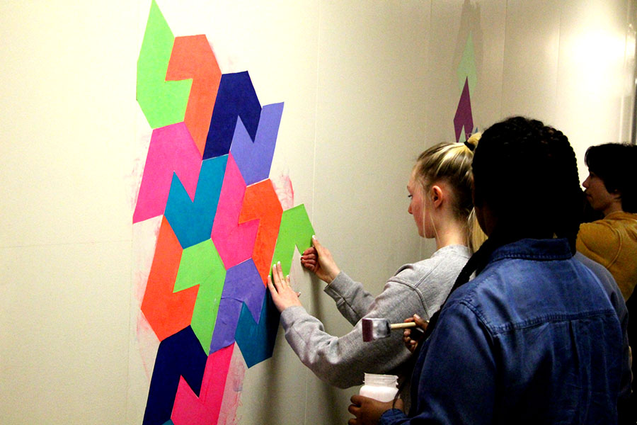 "Ms. Woldum's Open geometry class creates interdisciplinary projects every unit to match its focus on art. For their most recent unit, students are creating a mural on the wall outside Room 230. ""You kind of get to put your own creativity into the stuff you're doing, whereas in other math classes you kind of just take notes, and listen and do tests,"" said Noa Simon-Latz, a freshman in Woldum's class."
