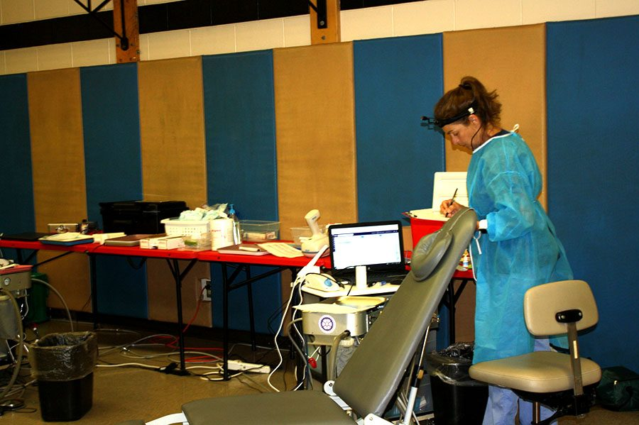 "Lisa Anderson, a dental worker for Operation Grace, records information about that day at the dental clinic. ""What we have done for [the students] is clean their teeth which is a really important thing to stay healthy and provide preventative care in the form of fluorides for their healthy teeth,"" said Anderson."