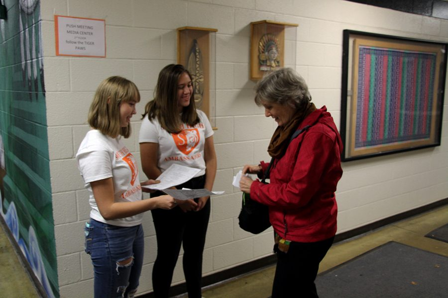 "Student ambassadors give maps of the school to parents at parent-teacher conferences.  Ambassadors, the organization that was known as ""link crew"" last year shows up to events like parent night, parent-teacher conferences, open house, freshman orientation, and more."