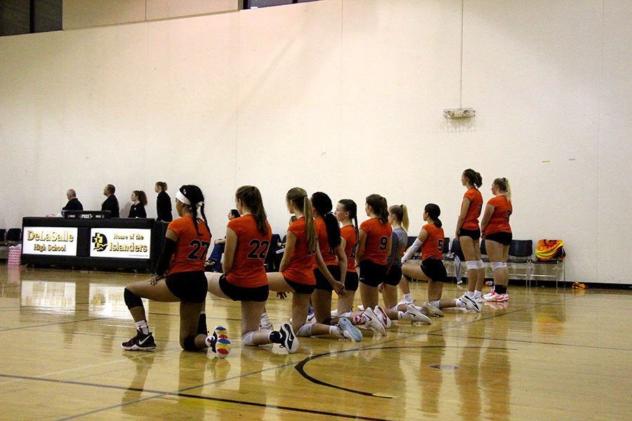 "The volleyball team's multiple year-long tradition of kneeling for the national anthem continues on despite the backlash from officials and the crowd during recent matches. ""For me, I'm just protesting what's going on in this country and the inequalities with race, gender, and stuff that I don't think is right,"" said junior and varsity player on the team, Marie Venberg."