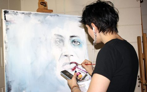 """In the back room of Cynthia Berger's advanced painting class, Senior Audrey Janz works on her latest piece. """"I'm really into realism and juxtaposition,"""" she said. """" I think there are a lot of different moods you can convey, with art."""""""