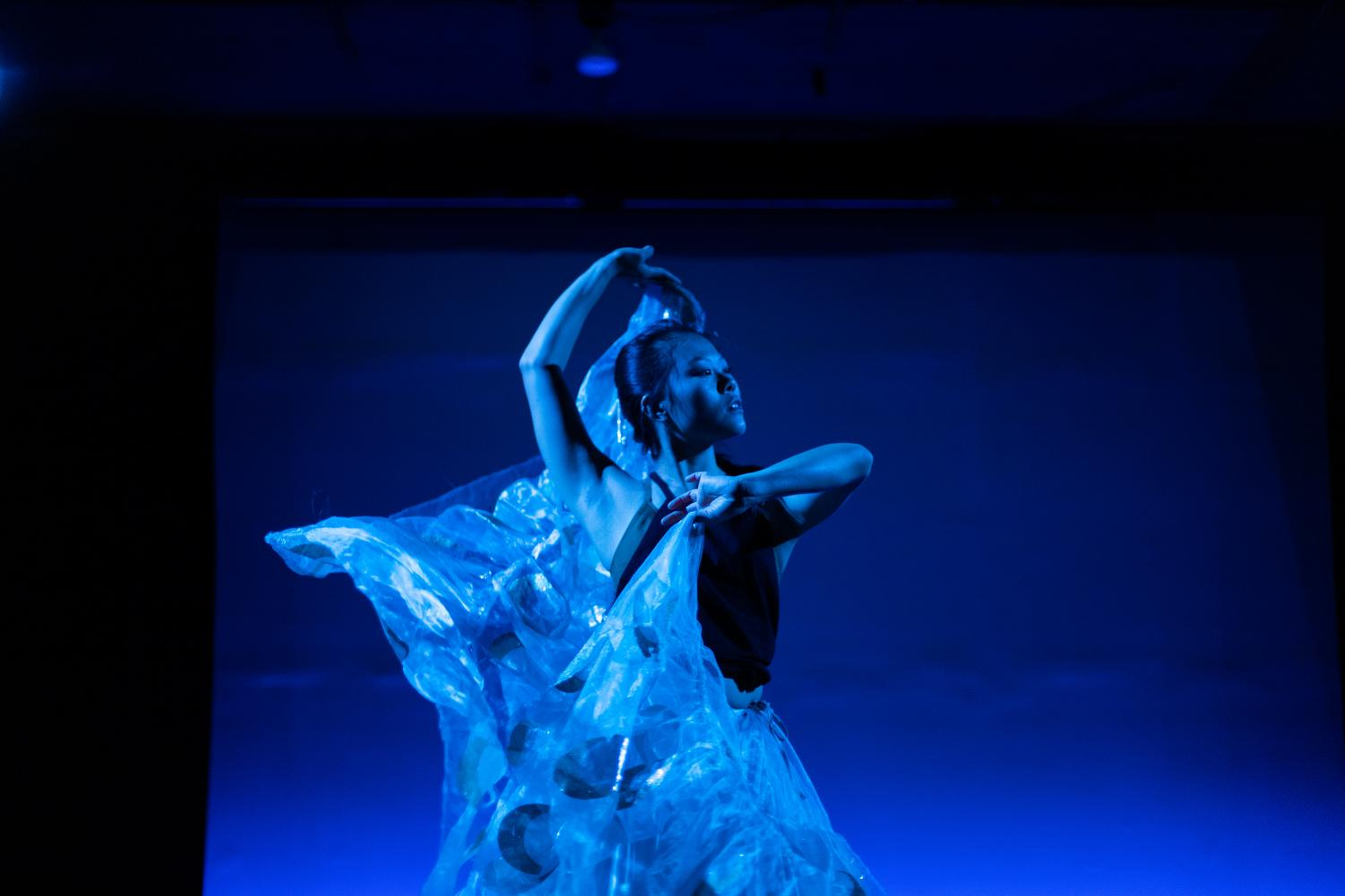 Nearing the end of the show, Julia Gay performs the serene Chinese peacock dance. As she moves and twirls, the dance just feels right: like an acknowledgment of grieving as well as a welcome to growth.