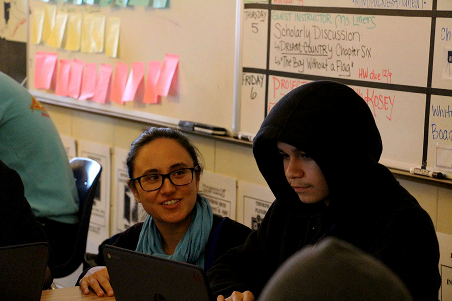 "New EL teacher Irene Mineoi Amrani helping sophomore Bernardo Martin. Mineoi taught abroad in two different countries in Asia. ""It was definitely a good experience... especially being an EL teacher it's really important to have lived in another country so you get an ounce of what your own students are going through."""