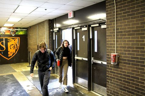 "Junior Mya Lynch and Senior Ian Mackimm enter South in the morning after the morning bell. ""Once you look at highschool and you look at adolescence, I think there's plenty of data that says that starting later is best for the brain,"" said Principal Brett Stringer."