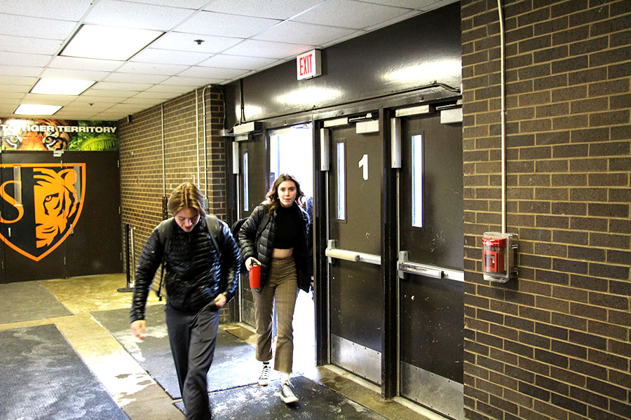 "Junior Mya Lynch and Senior Ian Mackimm enter South in the morning after the morning bell. ""Once you look at highschool and you look at adolescence, I think there's plenty of data that says that starting later is best for the brain,"