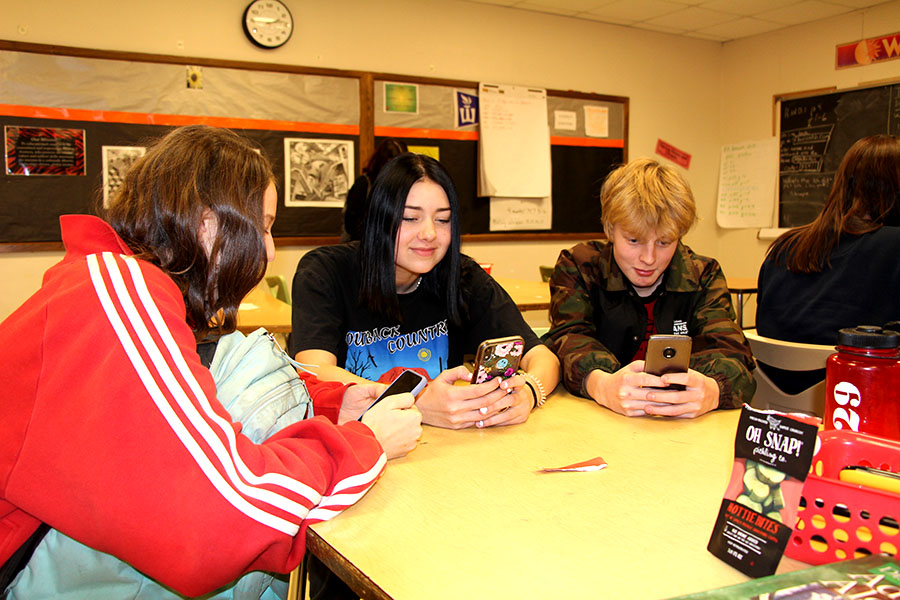 "South is in need of a standardized phone policy which would include students having more control over their phone usage in their free time at school. Students Olivia Teske, Cora Rubey, and Leo Barnhill pictured above are just some of the many students tired of the differing phone policies between classes. ""The phone policy should be that you can be on your phone during free time or independent work time and while the teacher is talking you have to listen and put your phone away...you can be on your phone, you can be listening to music, if you're done with your work and you show that you're done with your work, then you can use it."" says freshman Mackenzie Doyle."