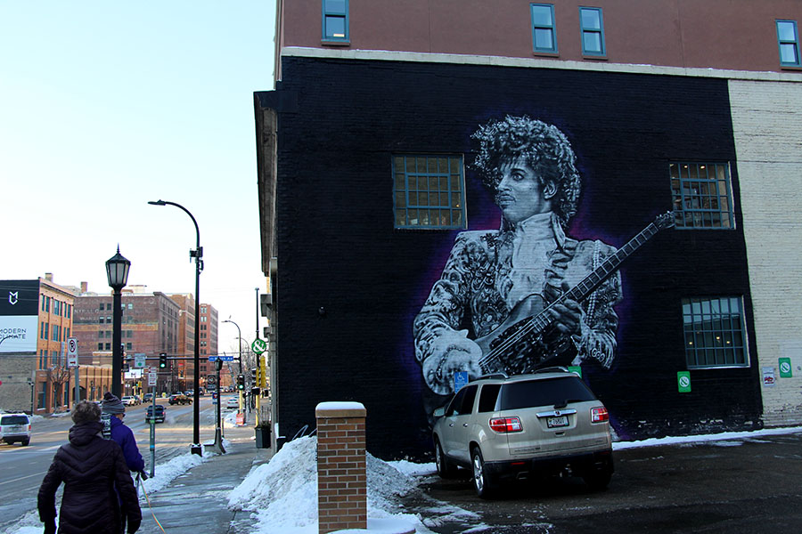 Prince+is+a+worldwide+inspiration+to+the+music+industry%2C+and+despite+his+passing+three+years+ago%2C+his+legacy+is+kept+alive+by+his+music.+This+mural+outside+of+Floyd%E2%80%99s+99+Barbershop+downtown+is+a+tribute+to+Prince+and+his+impact+on+the+world.+%E2%80%9CPrince+is+the+greatest+musician+and+performer+of+all+time.+Period.+He+changed+the+music+industry+forever...I+just+kept+going+back+for+more.+It+was+truly+a+%E2%80%98Purple+High%2C%E2%80%99%E2%80%9D+said+DJ+Dudley+D.%0A