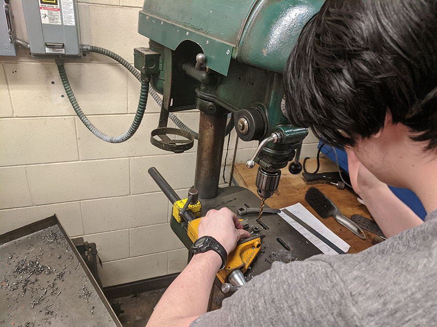 Pictured above is sophomore Jonathan Auckenthaler working on his ball peen hammer, the final project for machine shop. Machine shop is the only technical class South offers, despite just being one out of the hundreds of trades available.