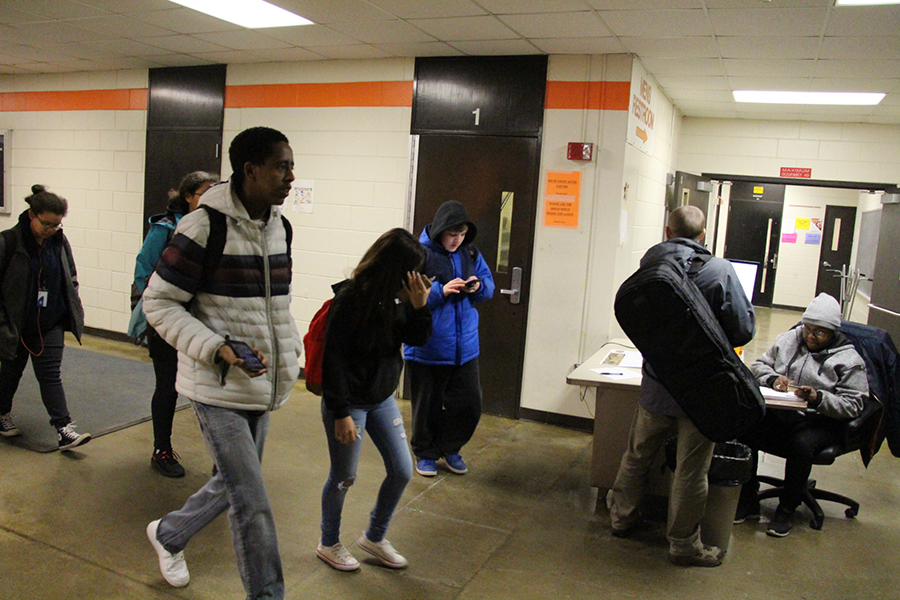 Pre-pandemic South High students walk past the welcome desk on their way into the building. Because of distance learning, interactions like these no longer take place. Alongside teachers and students, non-teacher staff members like counselors, administrators, and attendance clerks have faced unique challenges brought about by this pandemic.