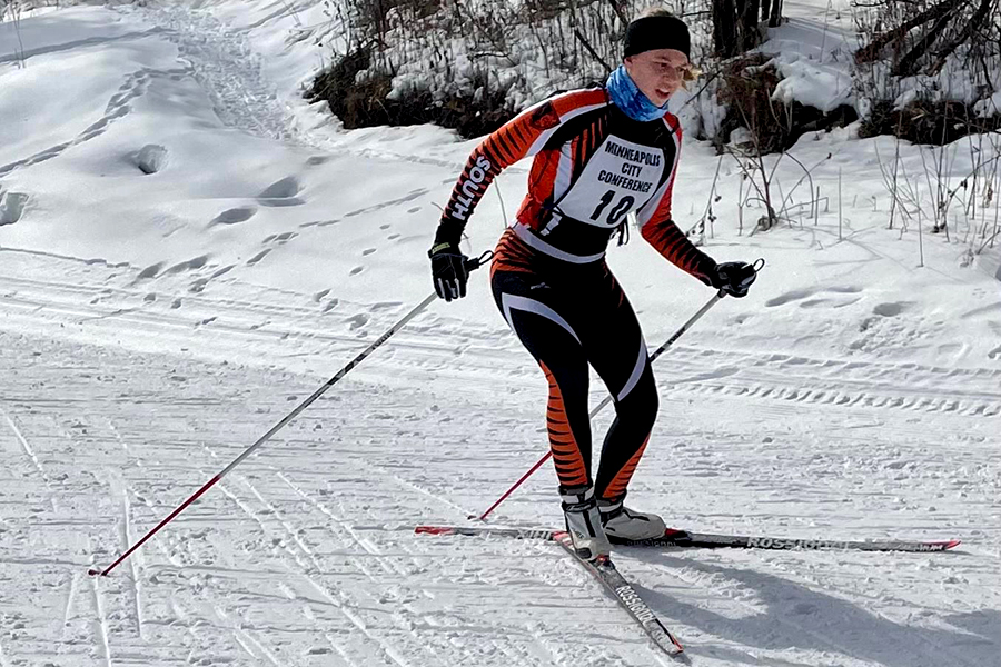 "Senior Eliana Storkamp, one of the captains of South's nordic skiing team, during a race this season.  ""For practice we are required to wear a mask the entire time, but for races it's different.  When you first are at the start of the race they want you to be wearing a [face covering]... and once you start racing you can put it down and put it back up when you finish.""  Photo credit: Kate Anderson"